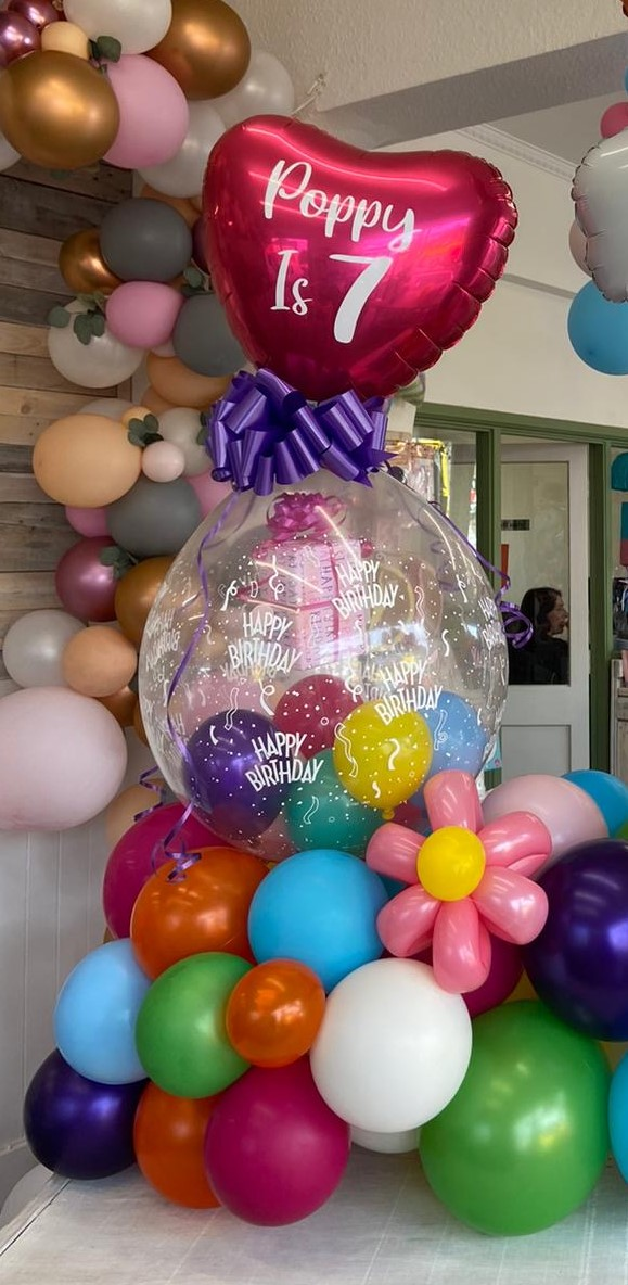 Birthday gift balloon and modelled flowers
